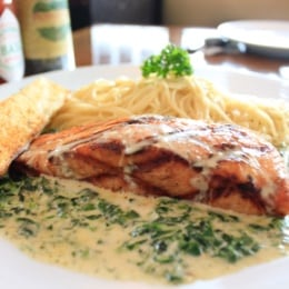 Salmon Florentine.....(Salmon marinated and grilled, served on a bed of sautéed spinach with a side of angle hair pasta. Topped with a lemon dill c